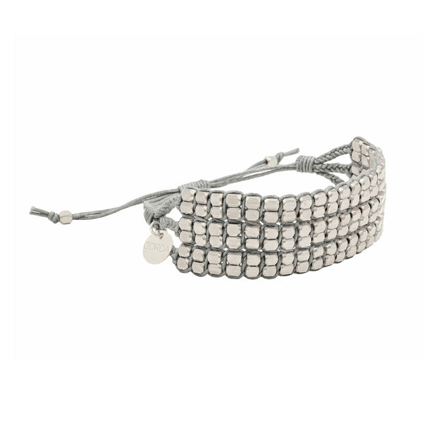 Tressa Statement Bracelet in Gray with Brass Beads