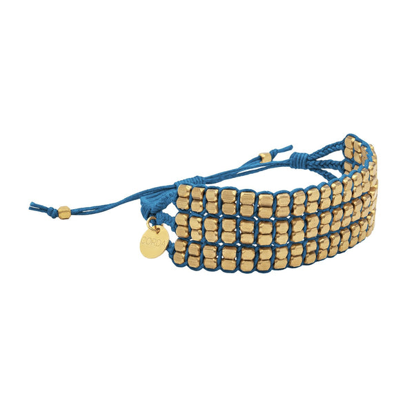 Tressa Statement Bracelet in Indigo with Rose Gold Beads