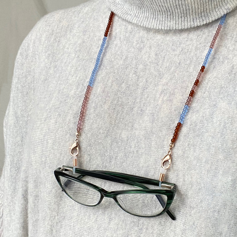 Translucent glass beaded eye glass chain that doubles as a mask chain. Cerulean blue, Rust and Mauve glass color block beads with Rose Gold clasps.