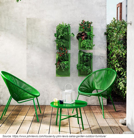 Small bistro set in a small garden setting.
