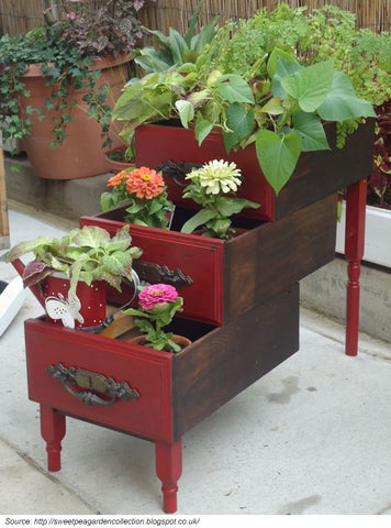 upcycled furniture being used as flower planters