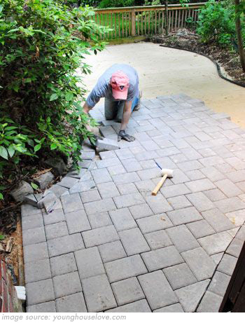 paving slabs being laid in garden