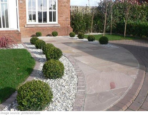 paved garden with shrubs and gravel