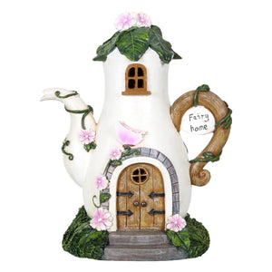 Fairy house coffee pot solar light.