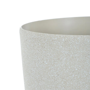 Close up of the Azuma tall beige stone effect round plant pot.