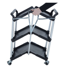 Load image into Gallery viewer, Folding up the Azuma wheeled service trolley cart.