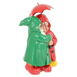 Standing gnome couple garden ornament.