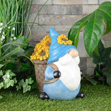 Load image into Gallery viewer, Novelty garden gnome ornament with basket of sunflowers and blue hat, standing on the grass in a garden with ivy, plants and a stone wall