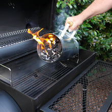 Load image into Gallery viewer, Using the Azuma bbq charcoal chimney starter.