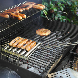 Azuma stainless steel BBQ sausage roller tool on the grill.