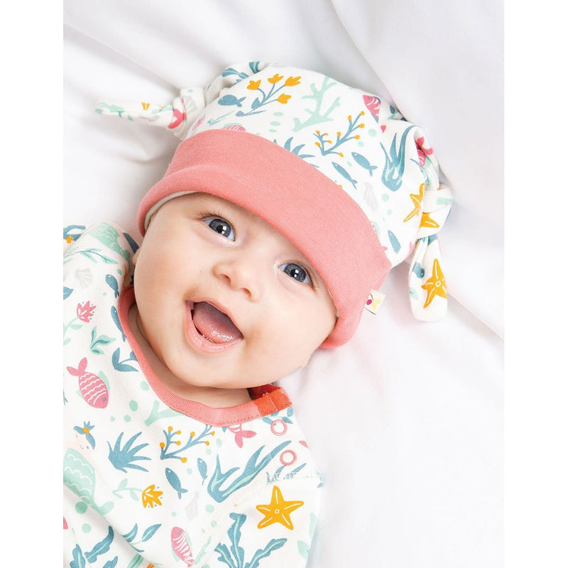 Baby girl wearing Frugi organic baby clothes