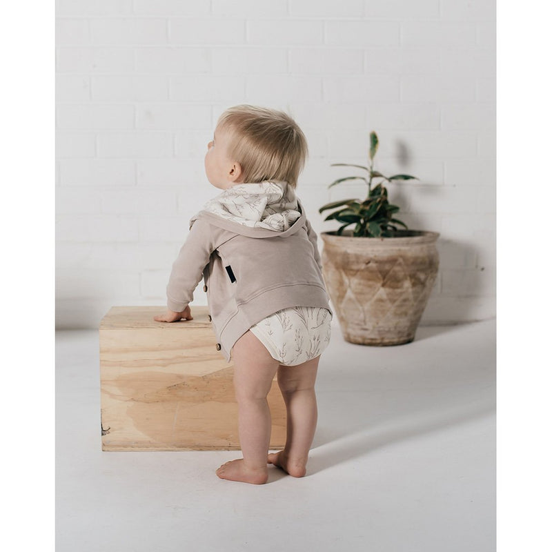 Baby wearing Aster & Oak organic baby clothes