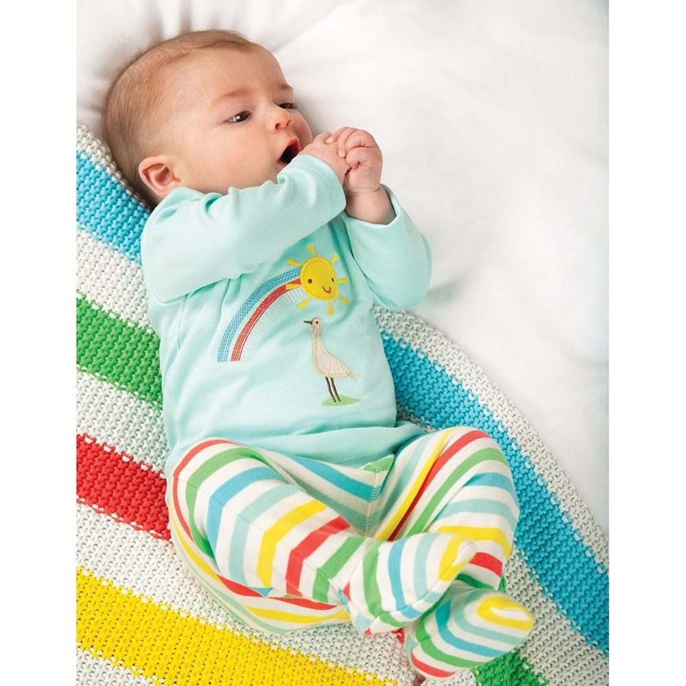 Baby on Frugi rainbow stripe Welcome Home Blanket