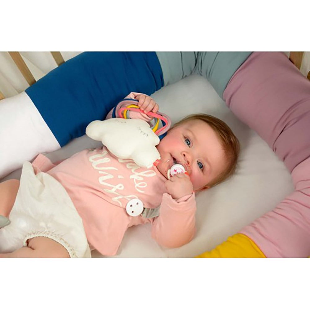 Baby with Kikadu cloud unicorn organic rattle