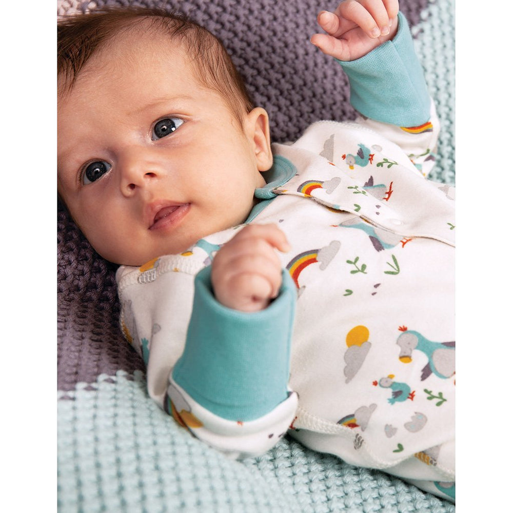Baby wearing Frugi organic baby growsuit - delightful dodos