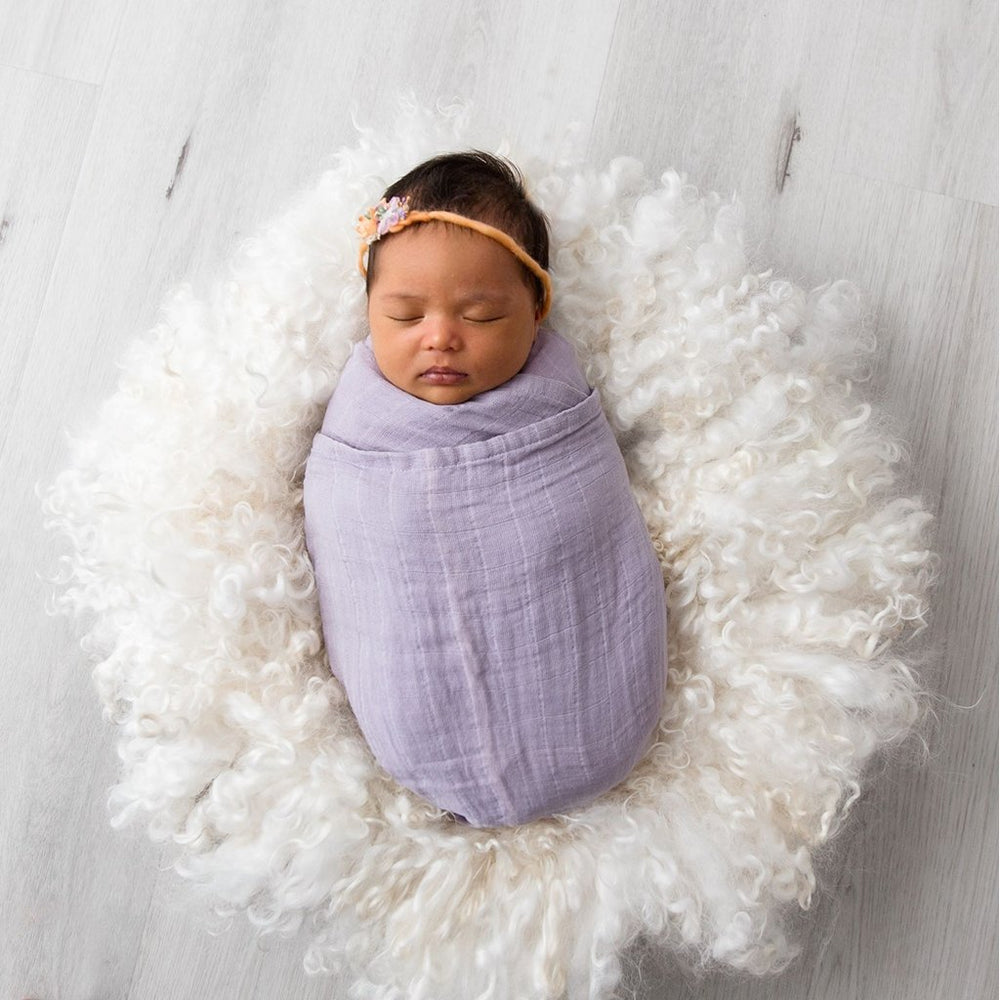 Baby in lilac Love & Lee muslin wrap