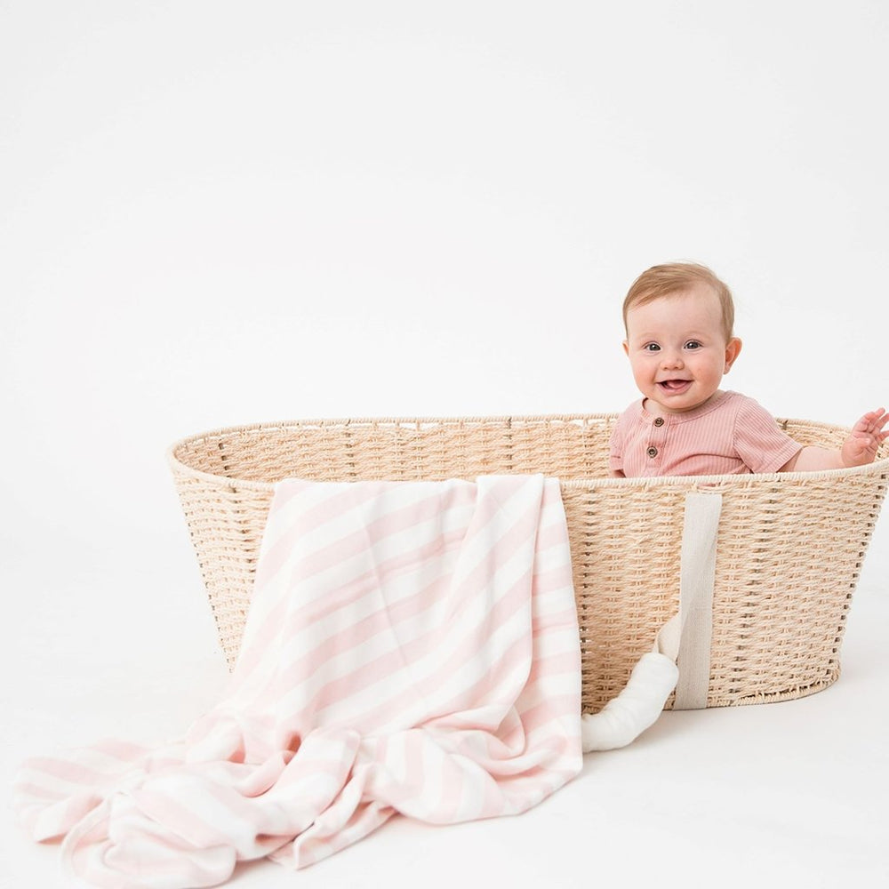 Baby in basket with Love & Lee pink stripe bamboo baby blanket