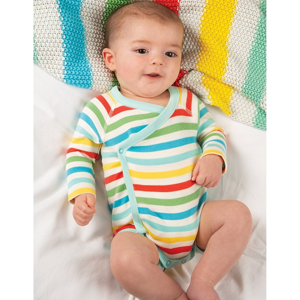 Baby wearing Frugi organic baby body - shay rainbow