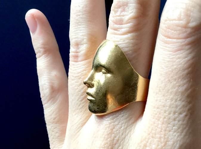 Golden digital face ring