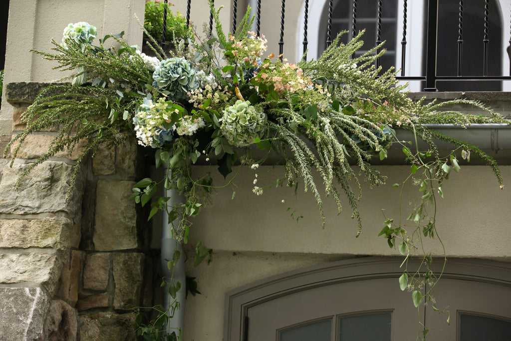 wedding arrangement in gutter from stone barn wedding by sewickley wedding florist