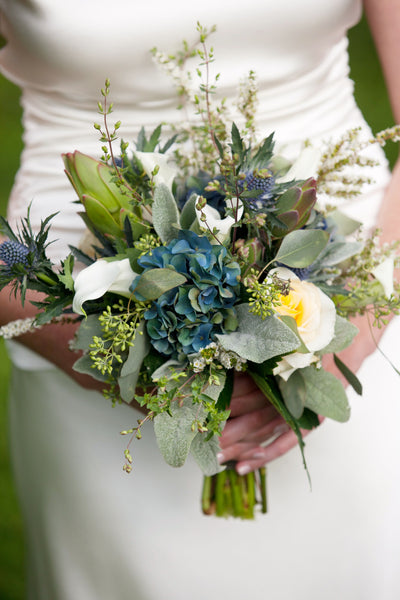 garden wedding bouquet from stone barn wedding by pittsburgh event florist