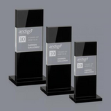 Three sizes of black glass awards