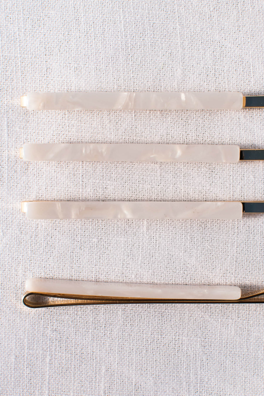 white pearl set of four acetate gold hair pins