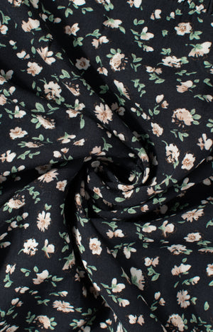 Romantic and feminine dark floral baby doll dress fabric texture detail Amantine Boutique