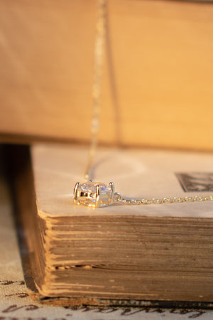 feminine french inspired minimalist diamond solitaire necklace