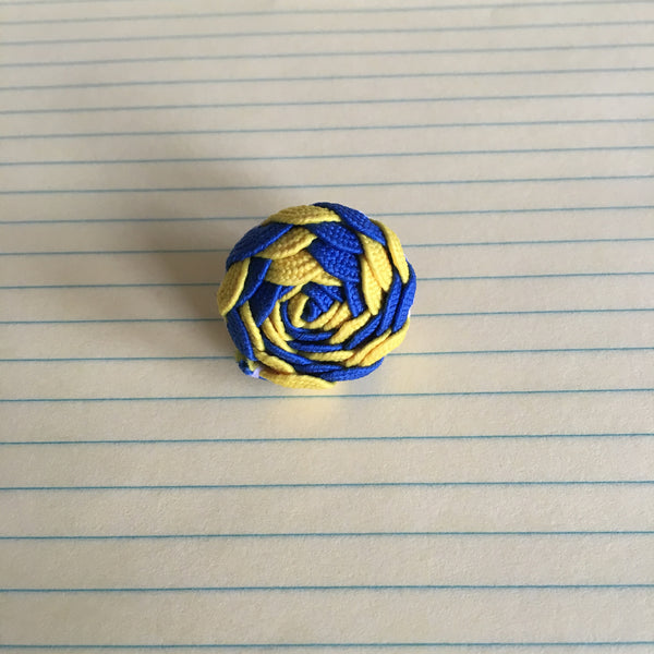 blue and yellow spiral knot lapel pin