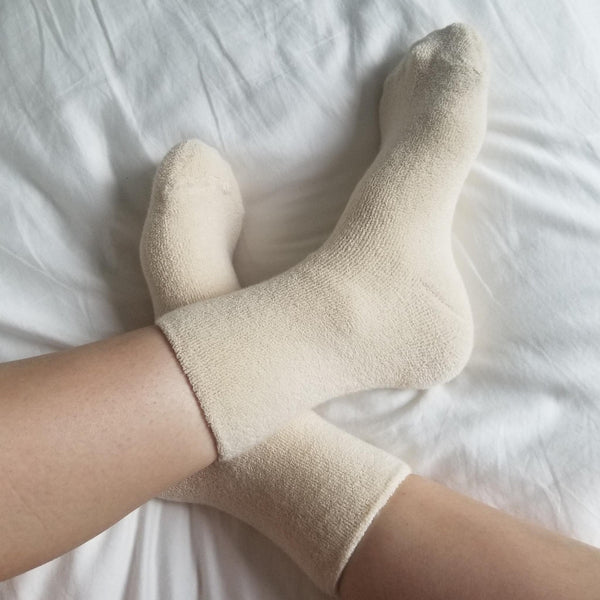cosy cream ankle length terry cotton socks on feet