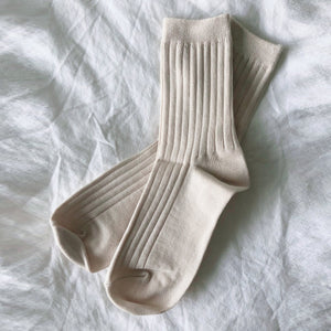 her socks in porcelain