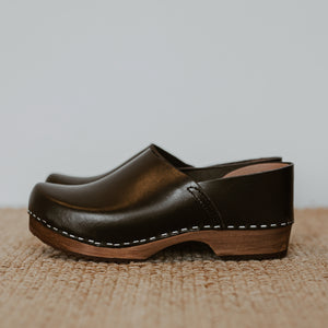 Onyx black classic style swedish clog with a covered back and a low heel