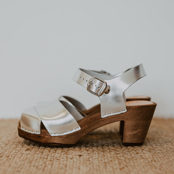 silver metallic cross over mid heel sandal clog with ankle strap