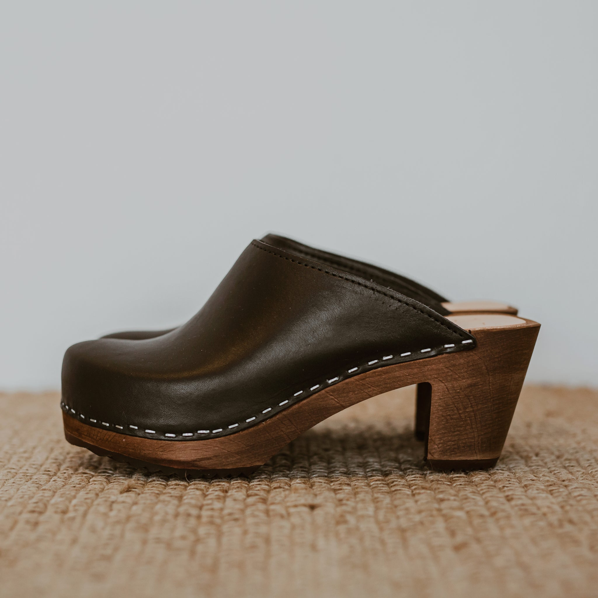 black onyx classic style swedish clog with a mid heel