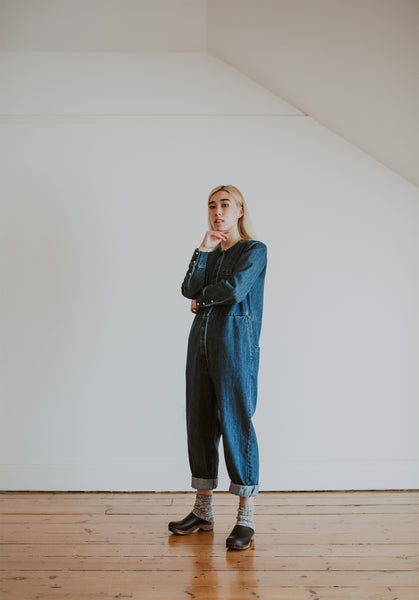 girl wears denim jumpsuit with organic, recycled cotton socks in a flecked dark grey and cream colour with a ribbed ankle with Onyx Low Klassisk clogs