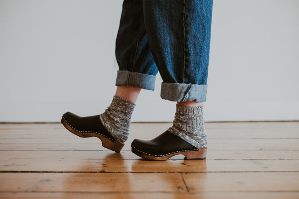 organic, recycled cotton socks in a flecked dark grey and cream colour with a ribbed ankle with Onyx Low Klassisk clogs