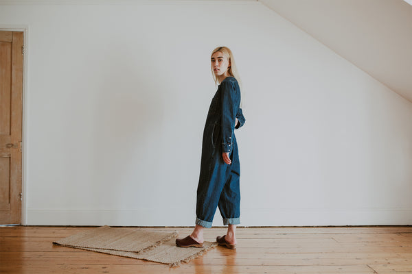 girl wear denim jumpsuit with garnet oxblood classic style swedish clog