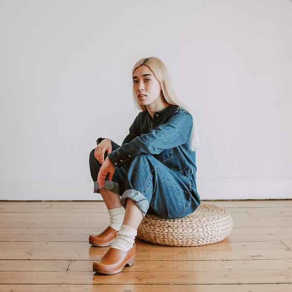 girl wears denim jumpsuit with organic, recycled cotton socks in a cream colour with a ribbed ankle with Cumin Low Jord clogs
