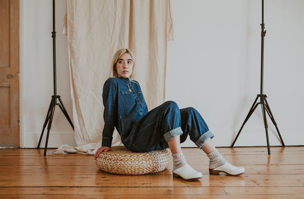girl wears denim jumpsuit with Organic, recycled cotton socks in a flecked ash grey and cream colour with a ribbed ankle and Ice Low Klassisk clogs