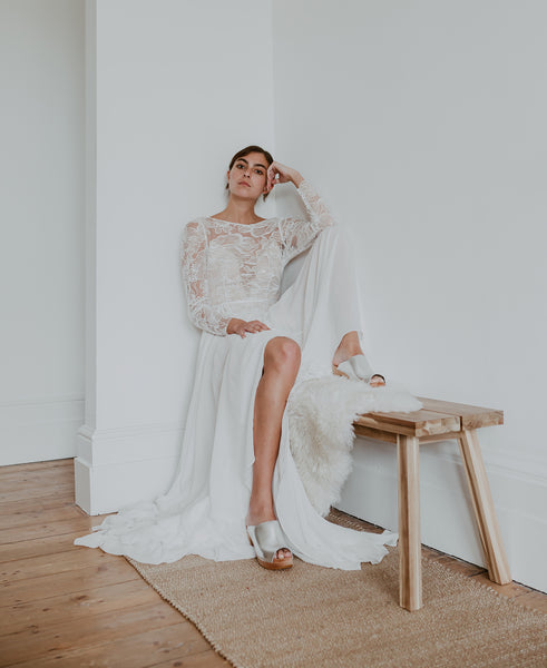 bride wears long wedding dress with silver peep toe classic style swedish clogs