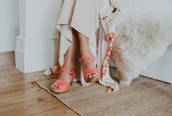 bride wears japanese kimono with pink flowers with peach pink peep toe bridal clogs