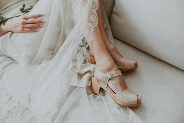 stone coloured peep toe bridal clogs with a white lace wedding dress and thistle