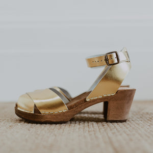 bridal wedding gold leather clog sandals with a mid heel and an ankle strap