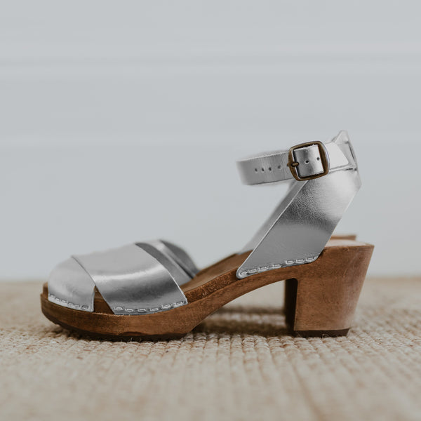 bridal wedding silver leather clog sandals with a mid heel and an ankle strap