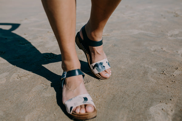 girl wears handpainted deep indigo navy contrasting strap single strap clog sandal