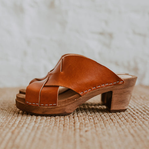 Cumin tan brown woven leather upper clog sandals with a mid heel and an open back and toe