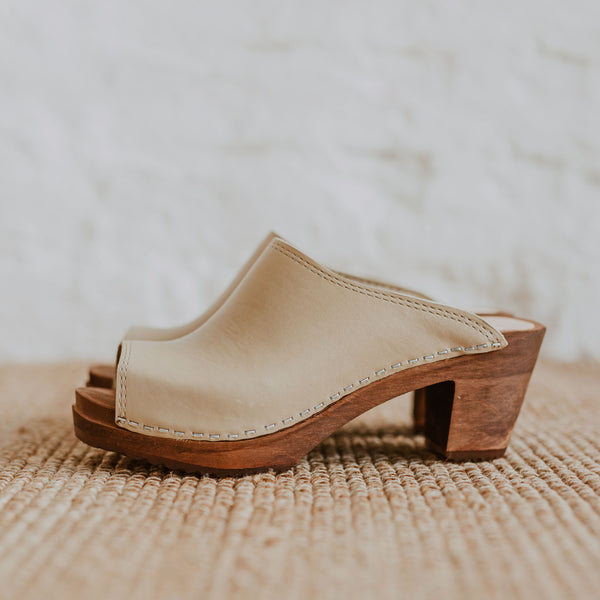 Stone beige coloured classic style mid heel swedish clog with a peep toe