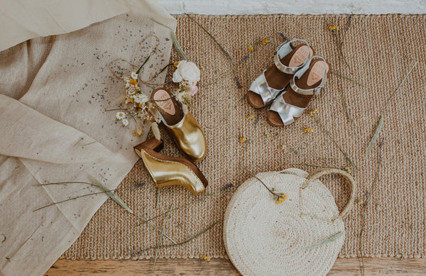 bridal wedding gold classic-style swedish clogs and silver crossover sandal bridal clogs with straw basket bag and feather headpiece