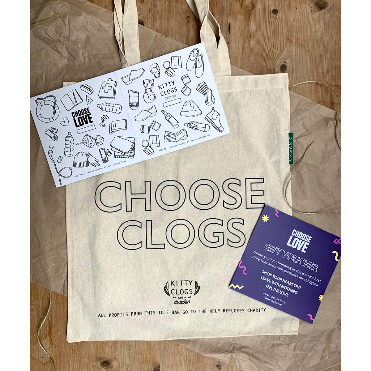 the giver gift set with gift voucher for Kitty Clogs and for a refugee through Choose Love, comes in a CHOOSE CLOGS tote bag